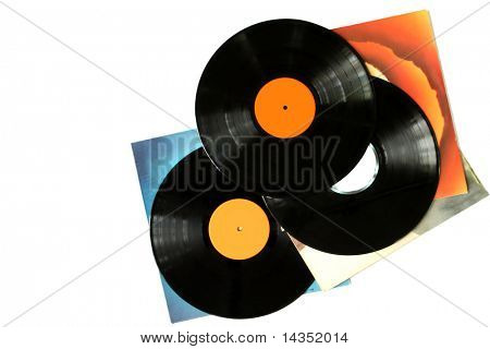Vinyl records and album covers, scattered against white background.