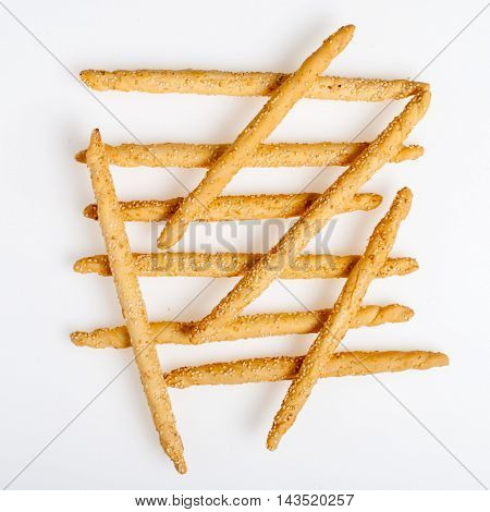 Excellent and natural breadsticks with sesame seeds with them clearly visible on the surface isolated on white background