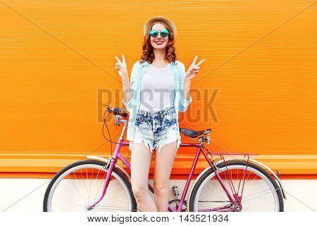 Fashion Pretty Smiling Woman With Bicycle Over Colorful Orange Background