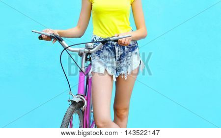 Fashion Pretty Woman With Bicycle Over Colorful Blue Background Closeup