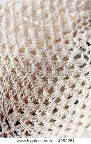 Crocheted doily in close-up - a lovely textured background.