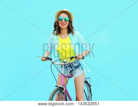 Pretty Smiling Woman Rides A Bicycle Over Colorful Blue Background