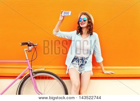 Pretty Smiling Young Woman Using Taking Self Portrait On Smartphone With Retro Bicycle Over Colorful