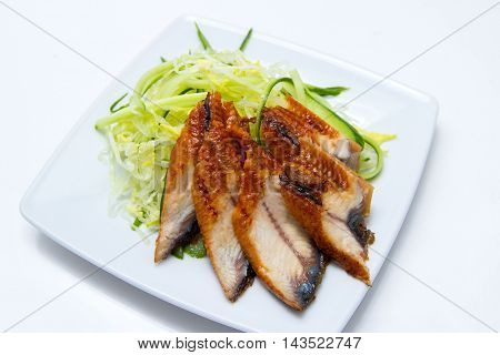 eel with cucumber and cabbage salad isolated in white