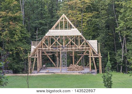 Building a new wooden house in the forest.