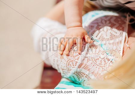 mother holding child hand and baby care