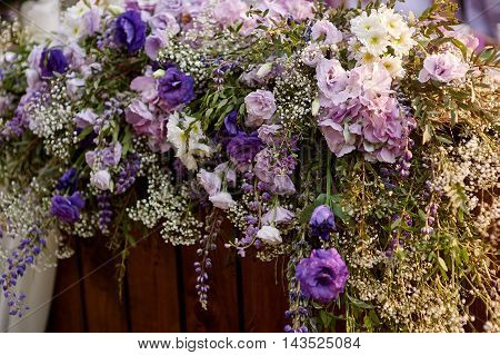 wedding arch decorated with flowers in the garden for the ceremony close up