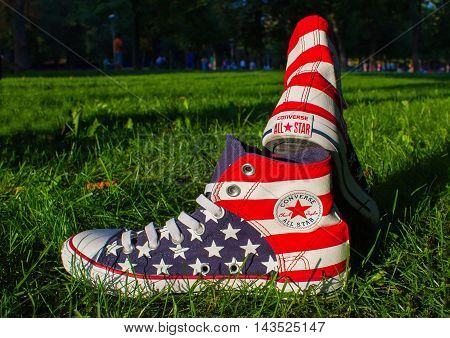 Dnipropetrovsk, Ukraine - August, 21 2016: All Star Converse sneakers on green grass in park