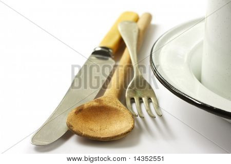 Vintage tableware ~ knife, fork, wooden spoon, and enamel bowl and spoon.