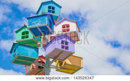 Beautiful bird houses against the blue sky