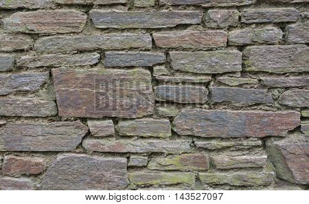 Wall from old stones in a horizontal format