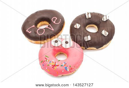creative donuts colorful, cream on a white background