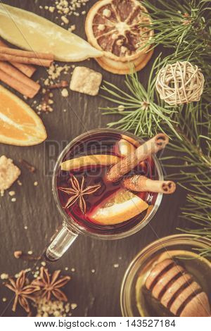 Mulled wine ingredients on dark stone background, top view, toned