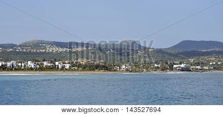 Latchi Beach with Neo Chorio on hillside Akamas Cyprus