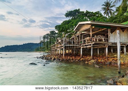 bungalow for backpackers on a tropical beach in evening time. Thailand