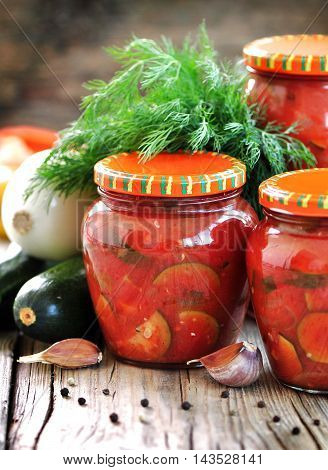 Zucchini marinated in tomato juice with onions and peppers