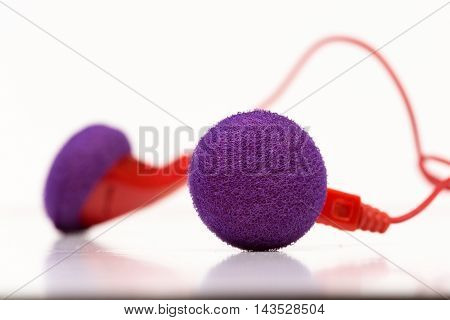 A pair of red with purple earphones