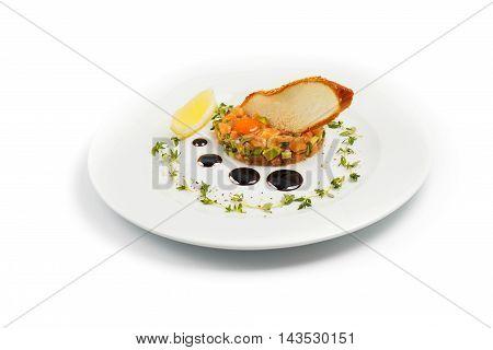 Salmon with Avocado Tartare with Lemon Slice isolated on white
