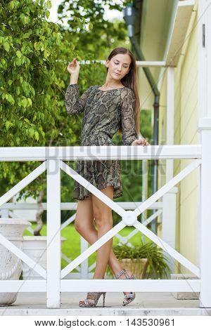 Young beautiful brunette woman in summer dress