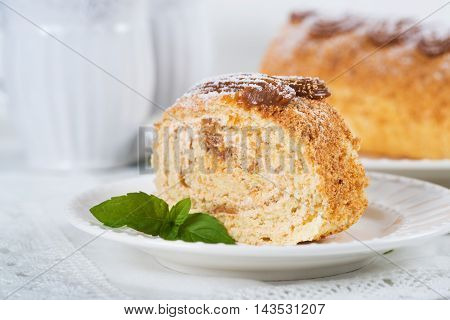 Biscuit roll with condensed milk on a table selective focus