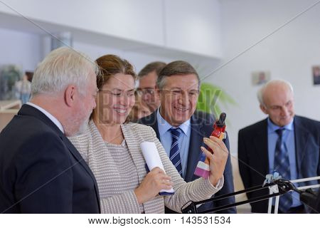ST. PETERSBURG, RUSSIA - AUGUST 9, 2016: General director of Imperial Porcelain Manufactory Tatyana Tylevich shows the production to vice-governor Igor Divinsky (left) during his visit to enterprise