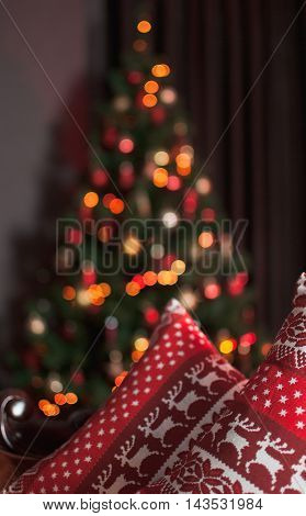 Christmas ornament with deer, tree and garland background