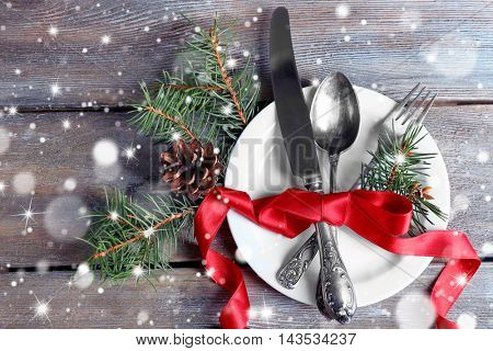 Holiday table setting with Christmas decoration. Snow effect