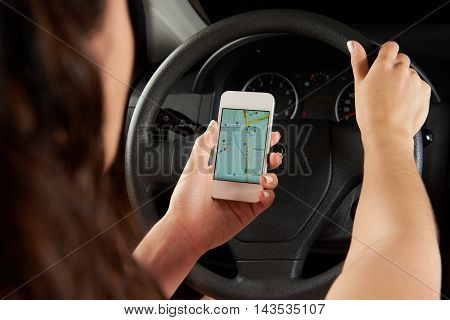Close Up Of Driver Hands Using Gps