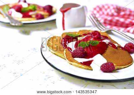Pancakes With Raspberry Sauce And Cream On A Vintage Plate.