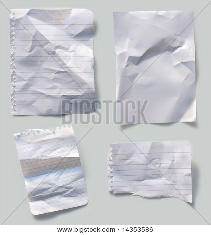 Collection of crumpled papers, casting natural shadow.