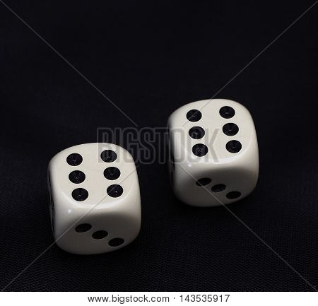 two dices double six on a black background