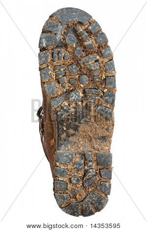 Muddy sole of a hiking boot, isolated on white.