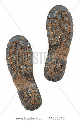 Muddy soles of hiking boots, isolated on white.