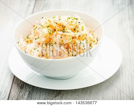 homemade fresh coleslaw served in a small bow.
