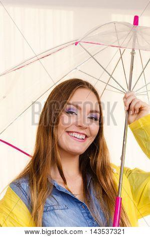 Woman Wearing Waterproof Coat Under Umbrella