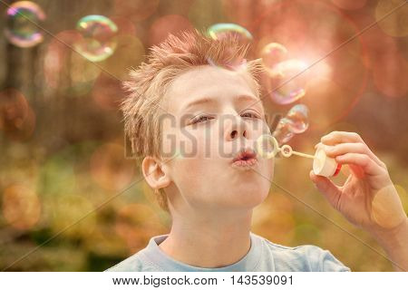 Boy Blowing Bubble Outdoors
