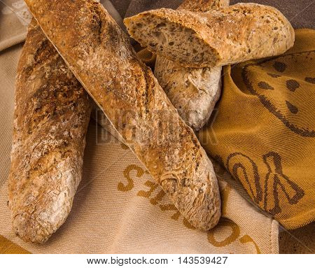 Fresh Alpine Baguettes with Pumpkin Sesame Chia Flax Seeds and rye sourdough starter. Healthy food concept.
