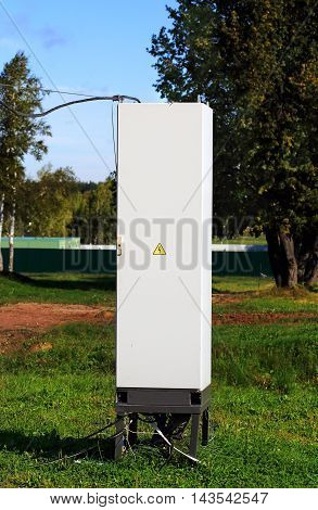 White metal cabinet with equipment for reception and distribution of electric energy
