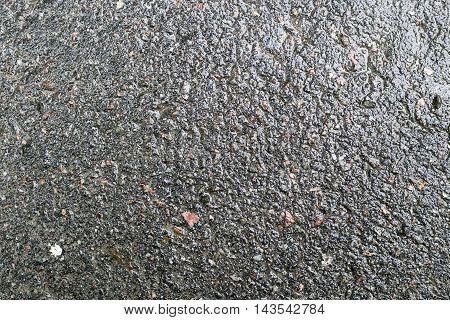 Fragment of textured asphalt after rain horizontal