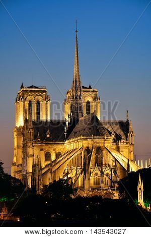 Notre Dame de Paris at dusk as the famous city landmark.