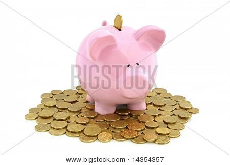 Piggy bank with golden coins, isolated on white.