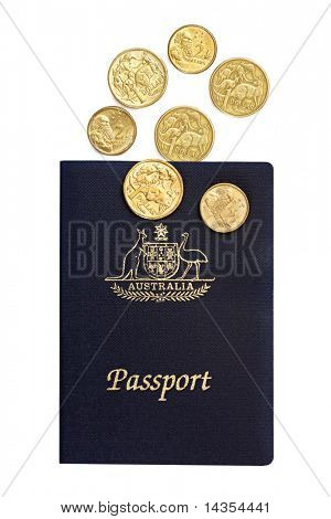 Australian passport with one and two dollar coins.  Isolated on white.