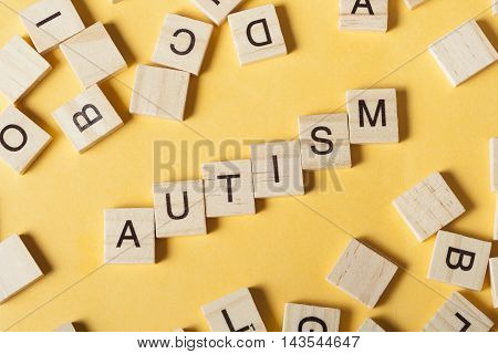 text of AUTISM on wood cubes. Wooden abc.
