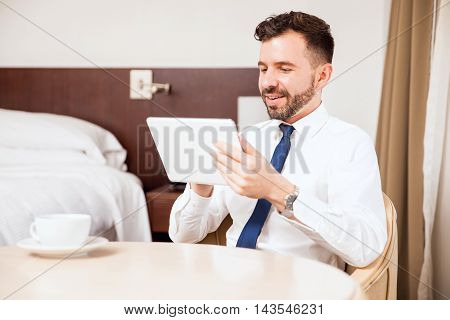 Businessman Using Tablet In Hotel Room