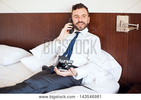 Young Businessman Requesting Room Service
