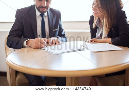 Businesswoman Closing A Deal With Client