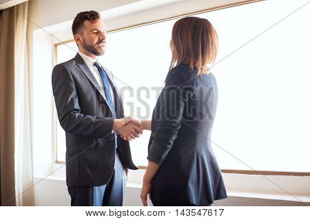 Business Partners Giving Each Other A Handshake