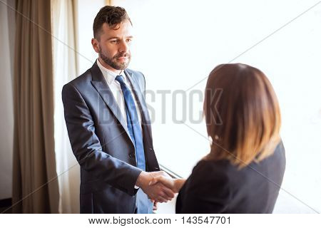 Business Manager Giving Handshake To A Client