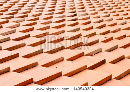 roof tiles background made of terracotta .