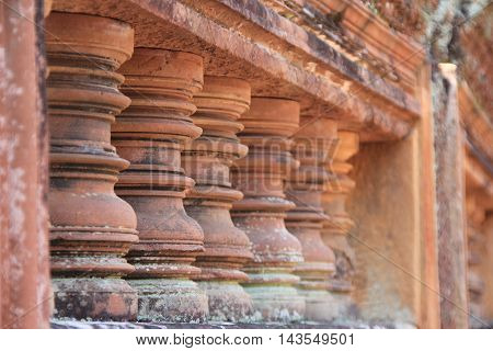 Red sandstone candle stones at Banteay Srei in Cambodia